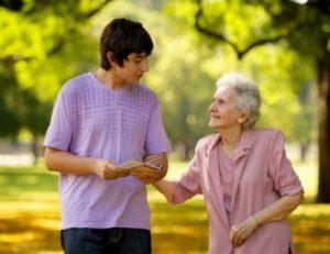 young-man-elderly-woman-visiting-1080937-print-848x496-520x400